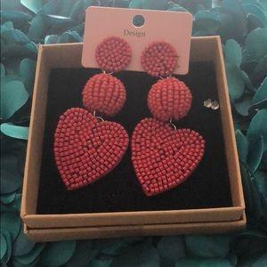 Adorable beaded heart post earrings.
